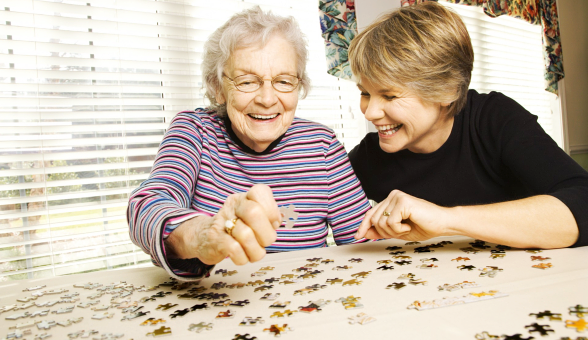 a lady and an old woman playing puzzle